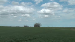 Time lapse clouds scurry above a wheat field on the Great Plains Stock Footage