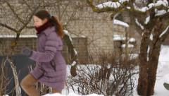 The girl running outisde in cold winter Stock Footage