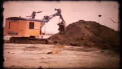 191 -  heavy equipment excavator digging at jobsite - vintage film home movie Stock Footage