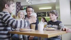2 cute little boys in a cafe enjoy sharing their milkshakes Stock Footage