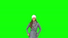 Happy young model in winter clothes jumping Stock Footage