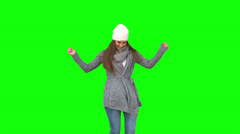 Happy young model in winter clothes dancing Stock Footage