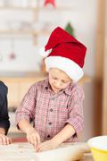 Cute little boy baking for christmas Stock Photos