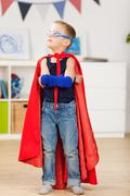 young boy dresses up as a superhero - stock photo