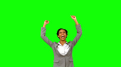 Pretty businesswoman raising arms on green screen Stock Footage