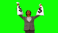 Stock Video Footage of Businesswoman holding money bags on green screen