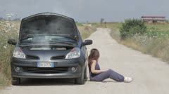 Broken down car, a woman calls with a cell phone a  help Stock Footage