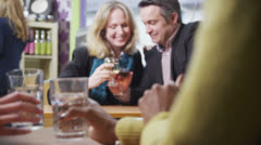 Mature couple in love drinking wine together in a cafe Stock Footage