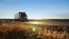 Truck passing on the road. Dolly shot.  Stock Footage
