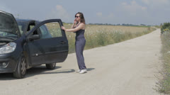 Upset businesswoman by the broken car, outdoors Stock Footage