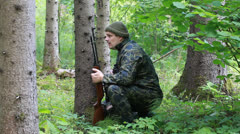 Man with optical rifle and binoculars in the woods episode 1 Stock Footage