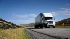 Delivering freight. Truck driving on freeway. Eighteen Wheeler.  - stock footage