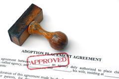adoption agreement - stock photo