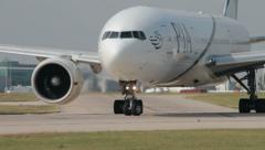 airplane taxis down the runway for take off pia boeing 777 - stock footage
