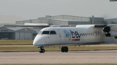 Flybe de havilland dash 8 plane taxis down the runway for take off Stock Footage