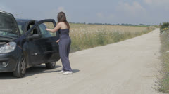 Woman with the broken down car on a country road ,call a auto mechanic Stock Footage