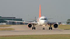 Airplane taxis down the runway easyjet airbus a320 Stock Footage