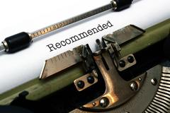 recommended text  on typewriter - stock photo