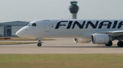 Finnair embraer 190 plane turns to taxi down the runway for take Stock Footage