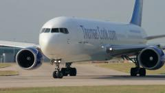 Airplane taxis on the runway for take off thomas cook boeing 767 Stock Footage
