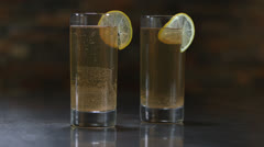 Two Perfect Glasses Of Ginger Beer With Lime On The Rim HD Video Stock Footage