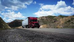 Trucks on road. Truck driving on the desert road.  - stock footage