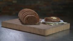 Pumpernickel Bread Sliced With Butter HD Video Stock Footage