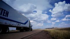 Trucks on road. Truck driving on freeway. Eighteen Wheeler.  - stock footage