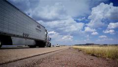Trucks on road, Truck driving on freeway. Eighteen Wheeler.  - stock footage