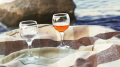 Joky scene on the beach: sea ​​freezes when notices quality wine - stock footage