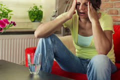 Woman taking painkiller pill for her headache NTSC Stock Footage