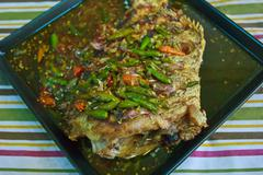Fried fish with garlic and chili 6 Stock Photos