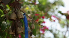Bells of wish on the tree near buddhist temple Stock Footage