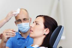 Anxious female patient at the dentist Stock Photos