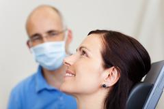 Pretty female patient smiling in dentistry Stock Photos