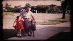 278 - grandparents & children pose outside for camera - vintage film home movie Stock Footage