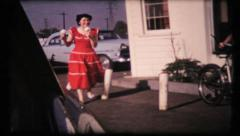 275 - couple go out for ice cream in the old Mercury - vintage film home movie Stock Footage