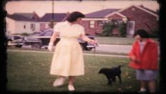 272 - walking the dog with mother & daughter - vintage film home movie Stock Footage