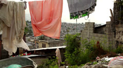 Laundry hanging over Port Au Prince - stock footage