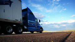 Truck dolly shot. Truck driving on freeway. Eighteen Wheeler.  Stock Footage
