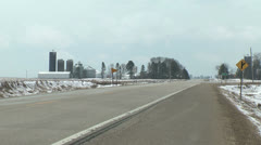 Minnesota highway passes farmstead Stock Footage