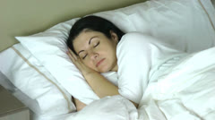 Woman sleeping on her bed at home having a very happy dream Stock Footage