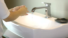 Washing of hands with soap under running water - stock footage
