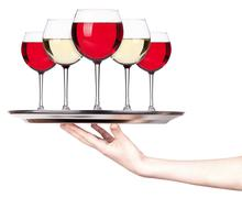 glass of Red and white wine on a silver tray - stock photo