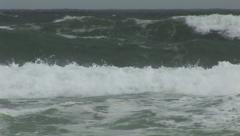 Swimmers in dangerous surf Stock Footage