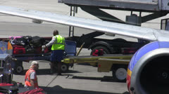 Baggage  Handlers Loading Plane Stock Footage