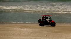Beach Firt Aid Vehicle Near the Ocean Stock Footage