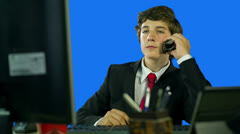 Boy In Business Suit In Office Talking On The Phone, Drinking Coffe Stock Footage