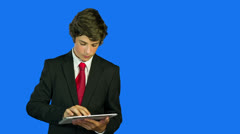 Business Kid Working On Tablet PC, Looking Important - stock footage