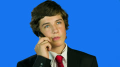 Boy In Suit With Red Tie Making A Call Stock Footage